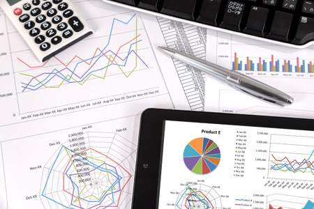 document management: Business performance analysis. Business Graphs with tablet, pen. Stock Photo