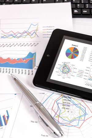 performance: Business performance analysis. Business Graphs with tablet, pen. Stock Photo