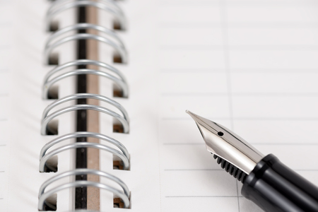 scribe: Fountain pen and notebook. As Business Image.