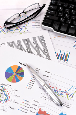 keyboard: Business performance analysis. Business Graphs with Keyboard, pen. Stock Photo