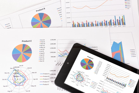 Business performance analysis. Business Graphs with tablet. Stock Photo