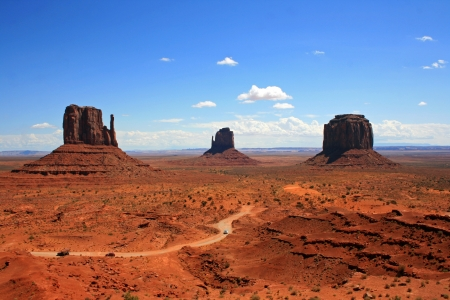 Landscape with three monuments in Monument Valley, Arizona photo