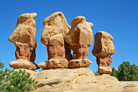 Four hoodoos in Devil s Garden, Utah photo