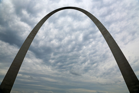 Silhouette of Gateway Arch on cloudy sky, St Louis, Missouri photo