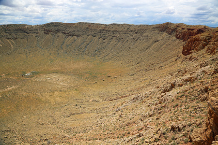a slope: West slope of Meteor Crater - Winslow, Arizona