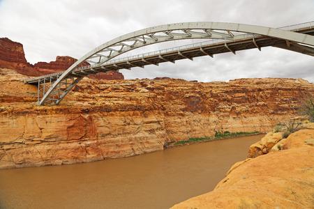 colorado river: Arch bridge over Colorado River - Utah Stock Photo