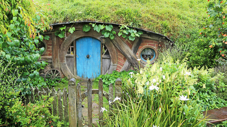 "Hobbit dugout with blue door - Hobbiton movie set made for ""Lord of the ring"" and ""Hobbit"" movies, Matamata, New Zealand, 1/18/2017"