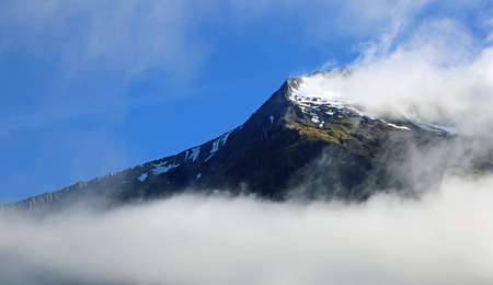 Wind on summit, New Zealand Stock Photo