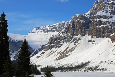 Dramatic cliffs on Bow Lake, Jasper NP, Canada Stock Photo