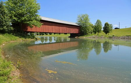Landscape with Mud River covered bridge, WV Stock Photo