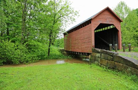 Green landscape with Dents Run Covered Bridge, West Virginia