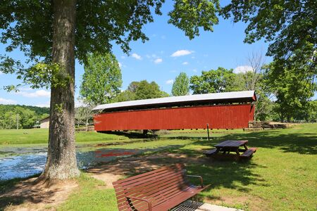 The park with Staats Mill covered bridge, West Virginia Stock Photo