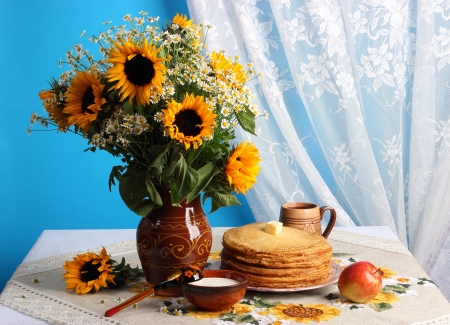 Still life with sunflowers and pancakes photo