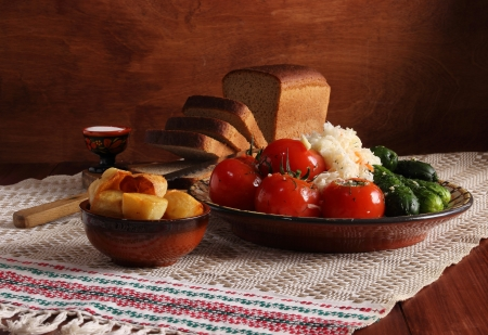 countrified: still life with bread and vegetables