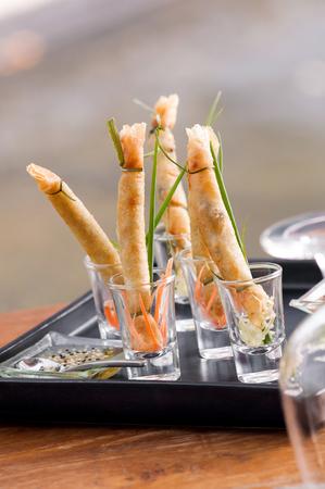 A la carte designed crispy deep-fried spring roll in mini glass serve for snack time Stock Photo