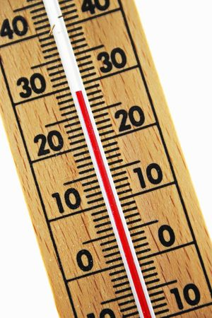 abstract wood thermometer isolated on white background photo