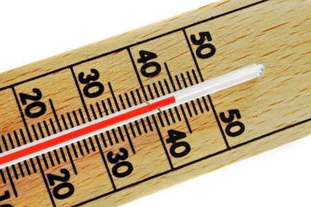 broiling: abstract wood thermometer isolated on white background in extreme hot temperature