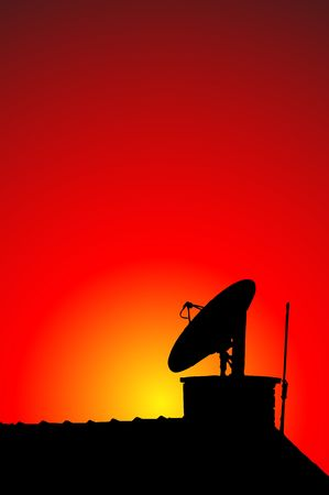 silhouette of a radio antenna on a roof photo