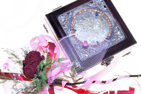 jilted: dry rose and jewelery box on white background