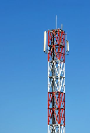 intercommunication: GSM network antenna on blue sky Stock Photo
