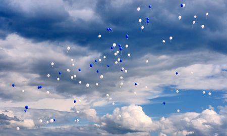 flying blue and white balloons photo