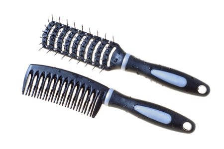 trashy: black comb isolated on white background