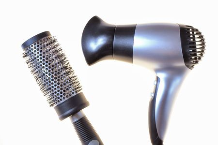 black comb and hair dryer isolated on white