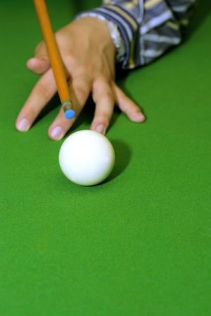 Snooker player hitting a ball, shallow depth of field photo