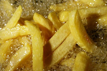 french fries - chips baking in oil Stock Photo - 1963619