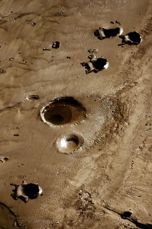 bottom of a dry lake with many holes in it Stock Photo - 3248905