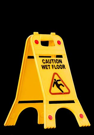 caution wet floor sign isolated on black photo