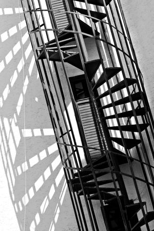 old spiral fire escape stairs, black and white photo Stock Photo - 3445982