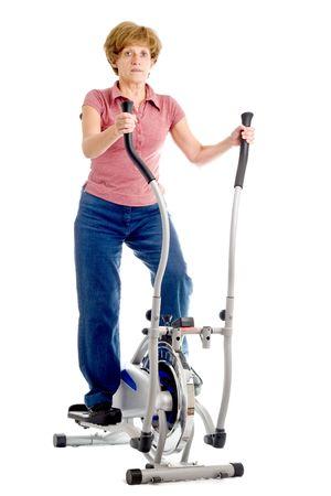 eliptica: mujer en el ejercicio de una el�ptica bicicleta estacionaria