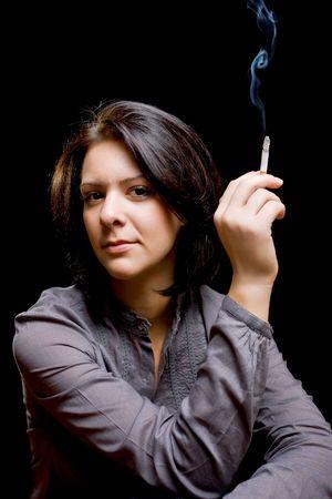 portrait of a beautiful girl smoking a cigar photo