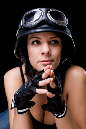 beautiful girl with US Army-style motorcycle helmet with goggles and gloves photo