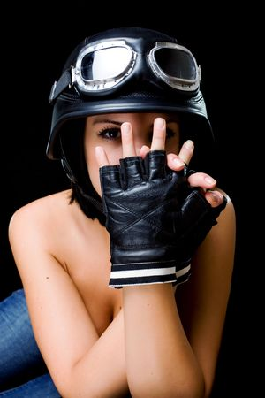 girl with US Army-style motorcycle helmet with goggles and gloves Stock Photo