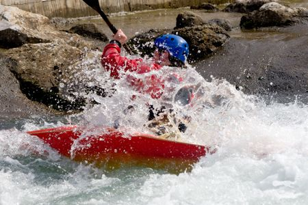 kayaker: kayaker manoeuvring in white water