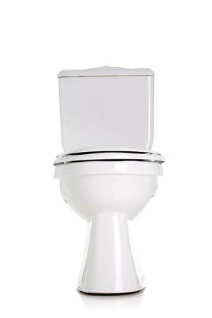 inodoro: inodoro cerrada, vista frontal, aislado en blanco Foto de archivo
