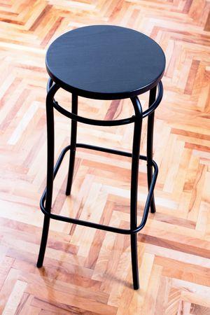 mixflooring: modern black bar chair on wooden floor
