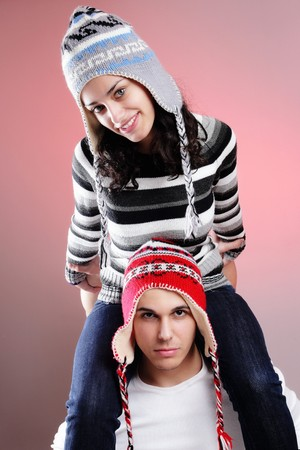 attractive young winter couple having some fun photo