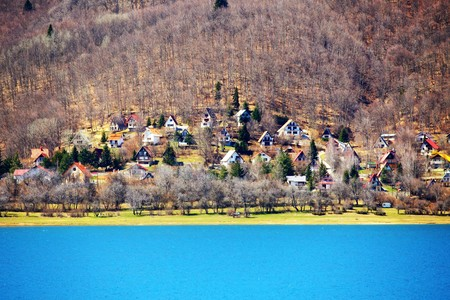 recluse: view of a settlement next to the Mavrovo Lake in Macedonia
