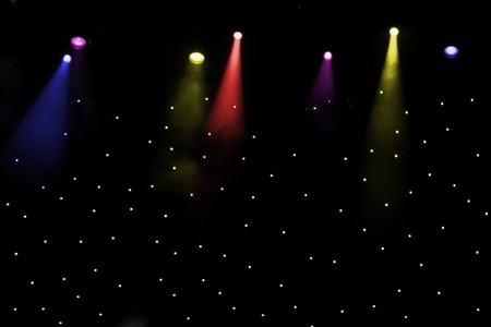 outdoor lighting: abstact music stage with multicolored lights