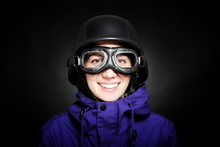 girl with us-army style helmet and goggles, on black photo