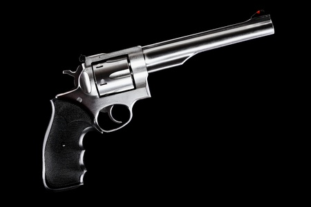 caliber: revolver against black background, 44 magnum caliber