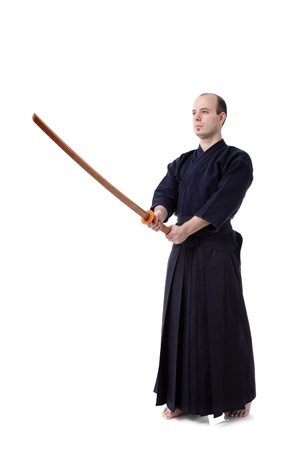 kendo fighter with bokken isolated on white photo