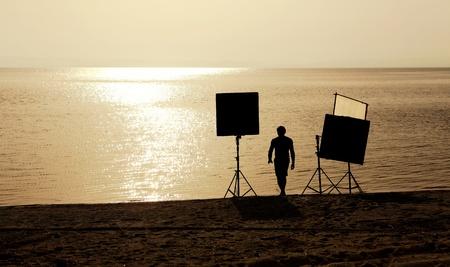 movie set: film crew setting up scene on a beach Stock Photo