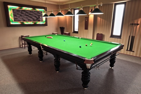 billiards tables: professional snooker table in a playing room
