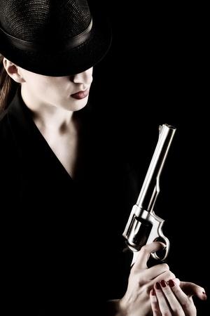 elegant lady in black holding a revolver  Stock Photo - 10264749