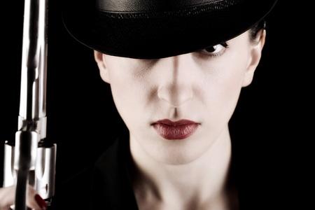 gangster girl: elegant lady in black holding a revolver