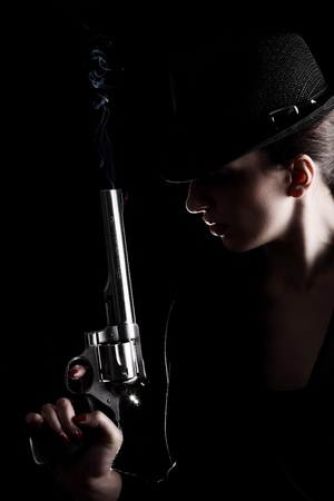 elegant lady in black holding a revolver  Stock Photo - 10264748